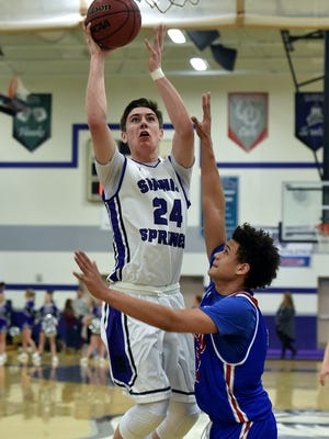 Spanish Springs' Josh Prizina goes up for two with Reno's Logan Shaw covering him in the first half of Tuesday's game at Spanish Springs.