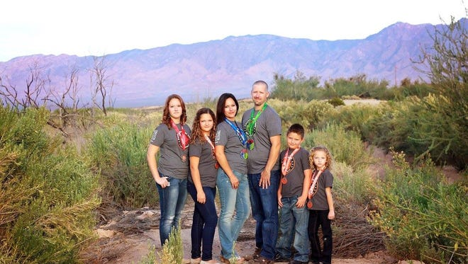 The Walker family will compete in the couple's seventh Spartan Race on Saturday.