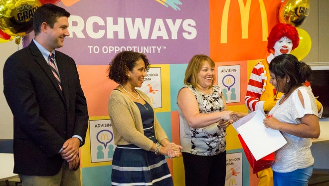 McDonald's celebrated the newest graduating class of 'English Under the Arches', an English language learning course for non-native speaking employees, with a ceremony in their honor in Iselin.