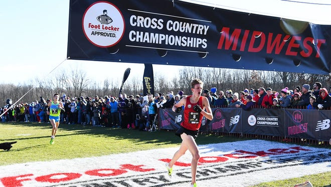 Homestead junior Drew Bosley crosses the finish line in 10th place at the Midwest Regional on Nov. 25 to earn a trip to the Foot Locker Cross-Country National Championships.