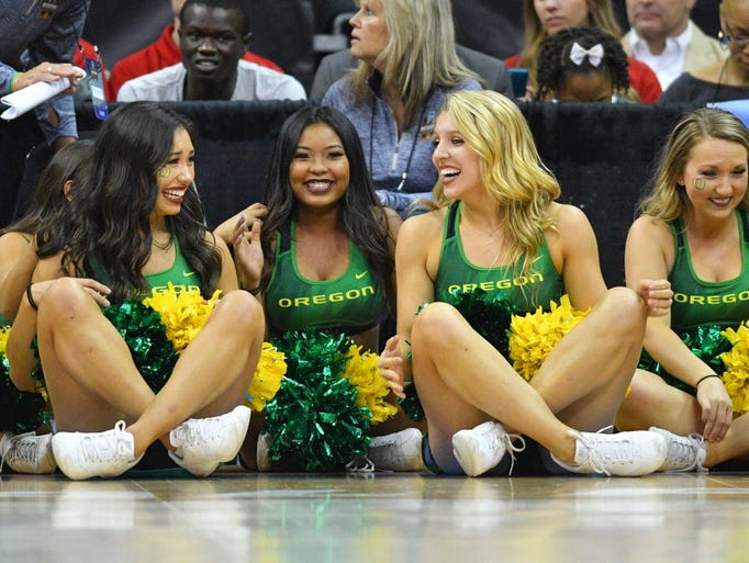 Oregon cheerleaders celebrate during the second half