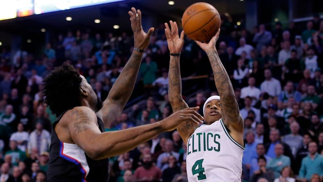 Boston Celtics guard Isaiah Thomas (4) makes the basket sending the game into overtime against the Los Angeles Clippers in the second half at TD Garden. Celtics defeated the Clippers in overtime 139-134.