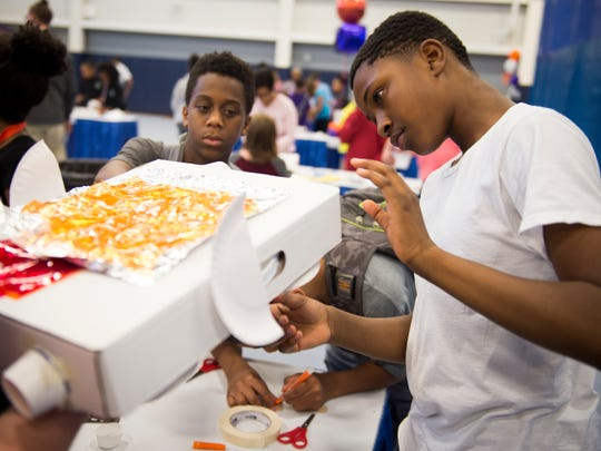 Children create a car for the Ford of the Future Challenge during Destination Imagination's Try DI event held at the Boys & Girls Clubs of the Tennessee Valley in Knoxville on Friday, May 19, 2017.