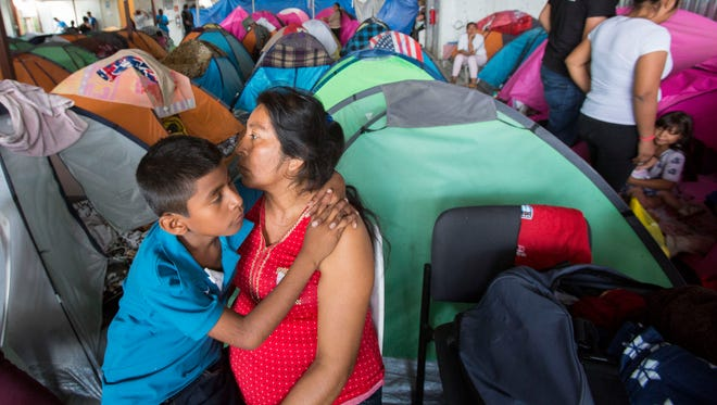 Manuela Candelaria Solano holds her young son June 20, 2018, at the Juventud 2000 migrant shelter in Tijuana, Mexico. Solano lost her husband to narco-violence in the Mexican state of Guerrero.