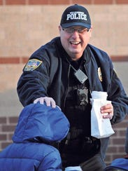 Williamsburg assistant police chief Bob Knoop laughs