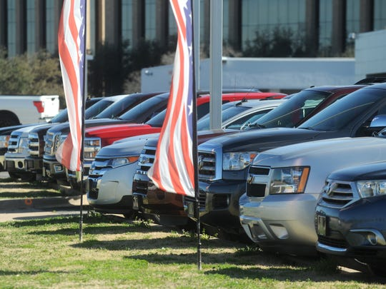 Cars for sale at a southside dealership. Spending on autos was down in 2016.