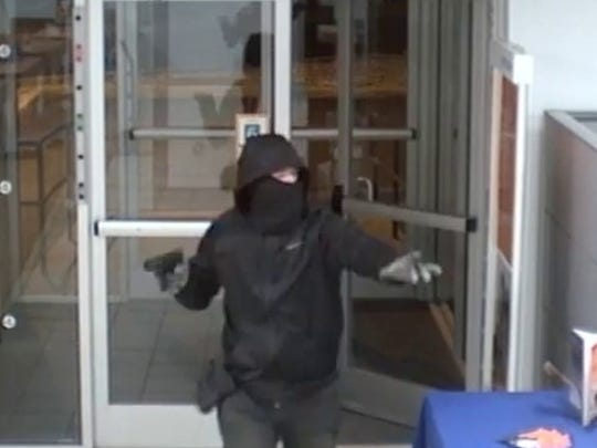 A robber enters a PNC Bank office in Evesham on Dec. 8, 2017.