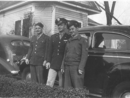 From left to right Sewell and Robert  Mitchell and Gaines Jeffcoat on military leave, visit the Mitchells' parents' home in Capitol Heights 1942.