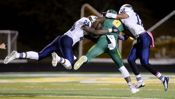 Roberson defenders make a tackle during a loss last