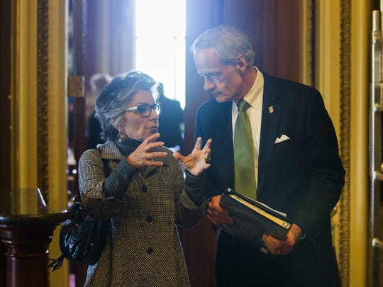 Sen. Barbara Boxer, D-Calif., chats with Sen. Tom Carper, D-Del., prior to voting on a much-debated trade bill on May 12, 2015.