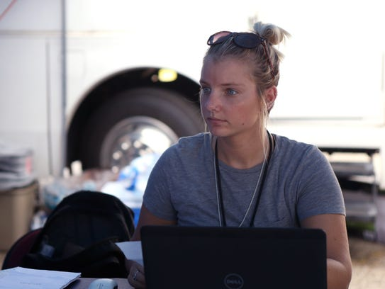Jaclyn Rogers, a reservist with FEMA, assists Corpus