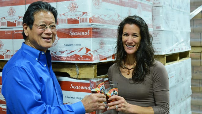 Highland Brewing will add 15 more jobs as part of its ongoing expansion. Pictured are brewery founder Oscar Wong, founder, and vice president Leah Wong Ashburn