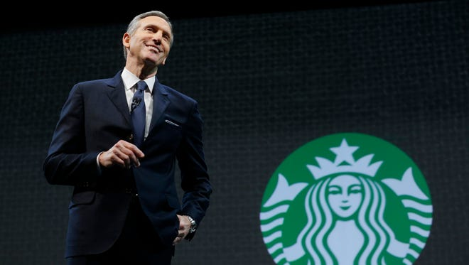 FILE - In this March 18, 2015 file photo, Starbucks CEO Howard Schultz speaks at the coffee company's annual shareholders meeting in Seattle. Starbucks will report earnings Thursday April 23, 2015.  (AP Photo/Ted S. Warren, File)
