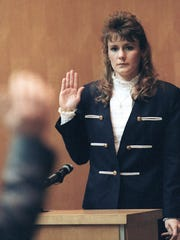Pamela Smart, 23, takes the oath before sitting in the witness stand in Exeter, N.H., in 1991. Smart, a teacher, was sentenced to life in prison without parole for her role in the murder of her husband, Greggory Smart, with four teenage students, all of whom have been released