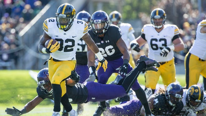 Derrick Mitchell Jr. runs for yardage during Iowa's 40-10 win at Northwestern on Oct. 17. The Hawkeyes' offensive line that day was back together on the practice field Sunday in Carson, Calif.