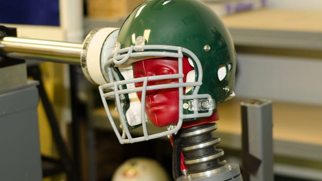 This handout photo provided by the Southern Impact Research Center in Tennessee shows equipment that can test how football helmets perform against certain concussion-causing forces. There is no concussion-proof football helmet, but an organization that sets safety standards for athletic equipment was preparing new testing criteria.