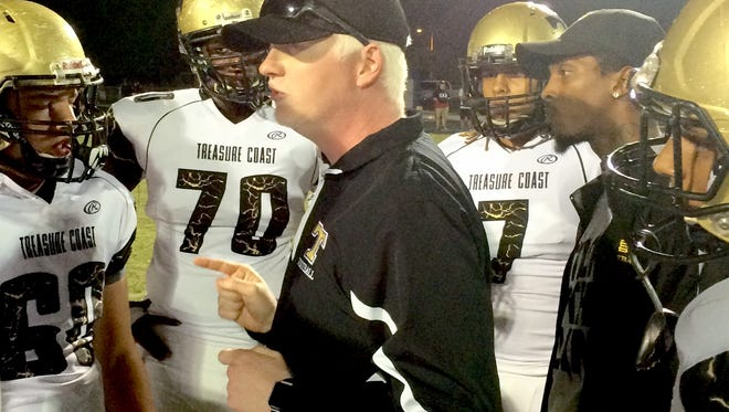 Treasure Coast High School football coach Devin Malloy, shown talking to Titans players during the team's upset of No. 2 ranked Osceola in the Region 2-8A quarterfinals on Nov. 11, 2016, passed away Sunday.