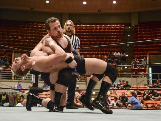 Matt Boyce is laid out by Alan Steel on Thursday evening at Oman Arena during a wrestling match in this June file photo.