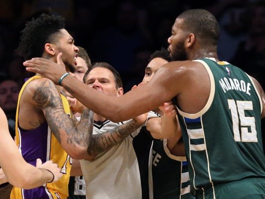 Los Angeles Lakers guard Nick Young, left, and Milwaukee Bucks center Greg Monroe confront each other during a fracas in the third quarter of an NBA basketball game in Los Angeles Friday, March 17, 2017. Three players were ejected. The Bucks won 107-103. (AP Photo/Reed Saxon)