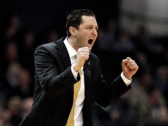 FILE - In this Feb. 9, 2019, file photo, Vanderbilt head coach Bryce Drew cheers on his players in the first half of an NCAA college basketball game against Alabama in Nashville, Tenn. Drew was fired Friday, March 22 after the worst season in the history of Vanderbilt men's basketball. Vanderbilt went 9-23 and was the first team in 65 years to go winless in the Southeastern Conference. Drew went 40-59 record in three seasons with the Commodores. (AP Photo/Mark Humphrey, File)