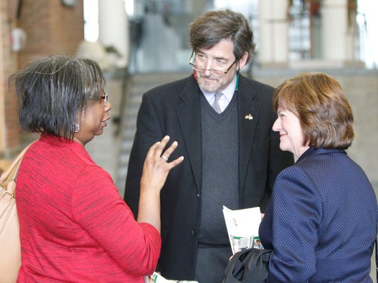 From left, Friends of Educational Excellence Partnerships board member Phyllis Walker chats with Hank Rubin and Jennifer Leonard of the Rochester Area Community Foundation  before   Wednesday's FREE Partnerships' meeting.