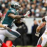 Eagles wide receiver Josh Huff stiff-arms a Tampa Bay defender on his way to the end zone Sunday.