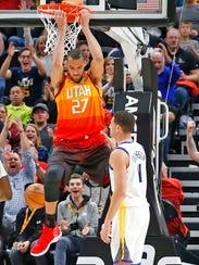 Utah Jazz center Rudy Gobert (27) dunks the ball as