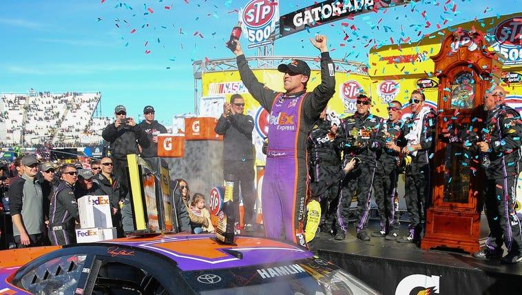 Sprint Cup Series driver Denny Hamlin (11) celebrates