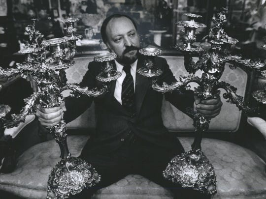Ernest DuMouchelle with some auction wares.