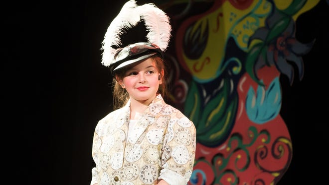 """A scene from """"Alice In Wonderland Jr."""" with Gabby Gomez as the White Rabbit."""