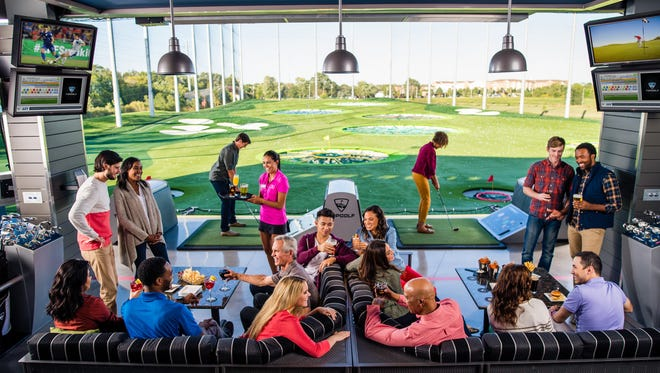 Guests playing Topgolf in Naperville, Ill.