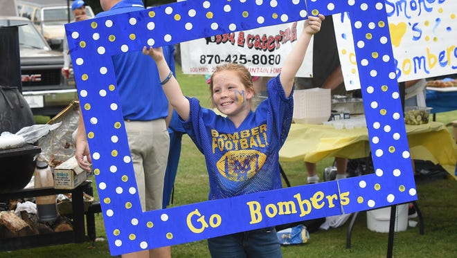 In this file photo, Avrey Wood, 10, cheers the Mountain Home Bombers during the 2015 BomberFest. The event is back for its eighth year on tonight.