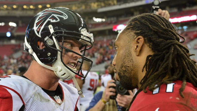 Cardinals wide receiver Larry Fitzgerald  talks with Atlanta Falcons quarterback Matt Ryan after their Oct. 27, 2013, game at University of Phoenix Stadium in Glendale.  The Cardinals beat the Falcons 27-13 and Ryan threw four interceptions.