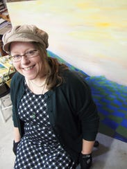 Barbara Moss of Eldorado with one of her abstract