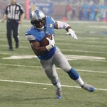 Lions running back Theo Riddick runs the ball to the 4-yard line Thursday at Ford Field.