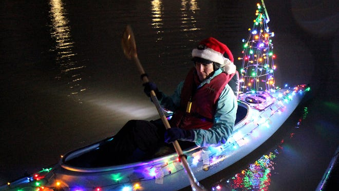 Karen Kraven of Salem was the first in the water at last year's Illuminata Regatta. The event returns 5:30 p.m. Saturday, Dec. 19, at Riverfront Park.