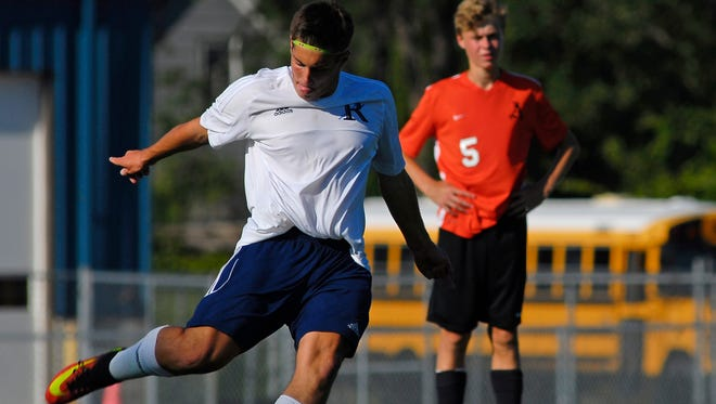 Blue Devils' Matthew Schuster gets a free kick Monday, Aug. 30, during a varsity soccer match against Almont at Richmond.