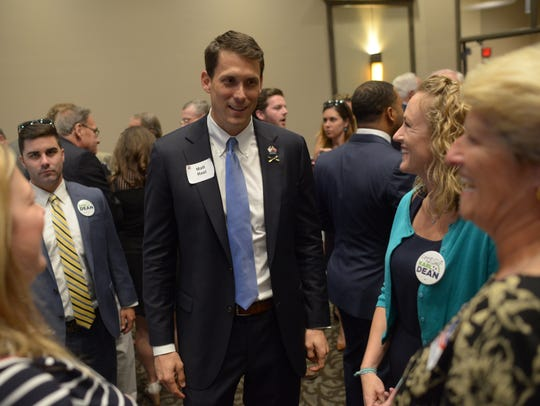 Matt Reel talks with supporters at the Tennessee Democratic Party Three Star Dinner at the Wilson County Expo Center in Lebanon on June 16, 2018.