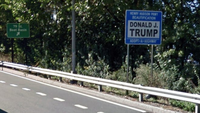 Donald Trump's Adopt-A-Highway sign on the Henry Hudson Parkway at 79th Street in Manhattan was temporarily removed as of Dec. 1, 2017, after a vandal splashed it with black paint.