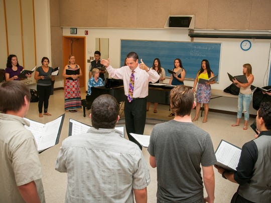 John Flanery, NMSU's new choral director, rehearses with singers at NMSU's Music Center.