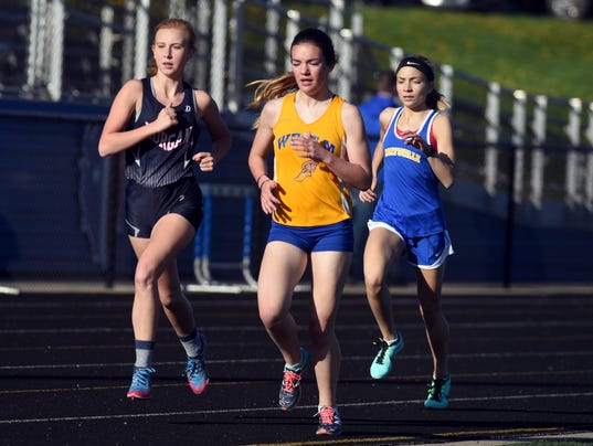 Morgan's Jozi Brown, left, West Muskingum's Megan Judson and Maysville's Molly Thompson run the 1600 meters during the Wayne Clark Invitational on Friday at John D. Sulsberger Memorial Stadium.