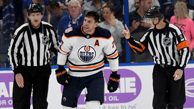 Edmonton Oilers left wing Milan Lucic heads toward the penalty box during the third period of Tuesday's game against the Tampa Bay Lightning. (AP Photo/Jason Behnken)