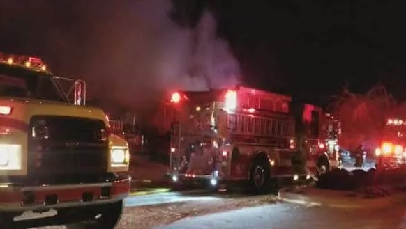 Crews battle a fire at a mobile home in Harrison on Tuesday night.