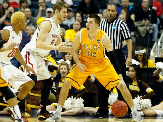 Valparaiso forward Alec Peters (25) dribbles while