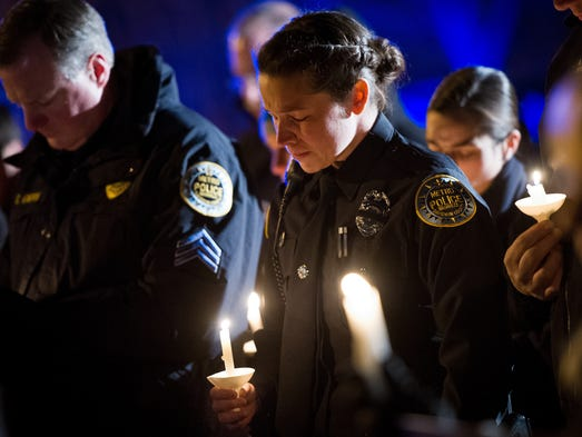 Metro Nashville Police Officer Ashton Navarro holds