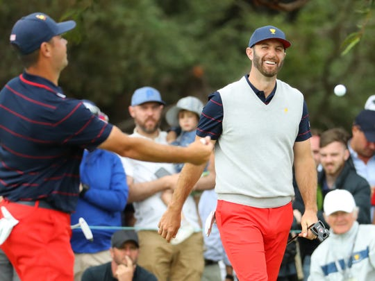 MELBOURNE, AUSTRALIA - DECEMBER 14: Dustin Johnson of the United States team and Gary Woodland of the United States team react on the 17th green after defeating Louis Oosthuizen of South Africa and the International team and Adam Scott of Australia and the International team 2&1 during Saturday afternoon foursomes matches on day three of the 2019 Presidents Cup at Royal Melbourne Golf Course on December 14, 2019 in Melbourne, Australia. (Photo by Warren Little/Getty Images) ORG XMIT: 775408821 ORIG FILE ID: 1193845478
