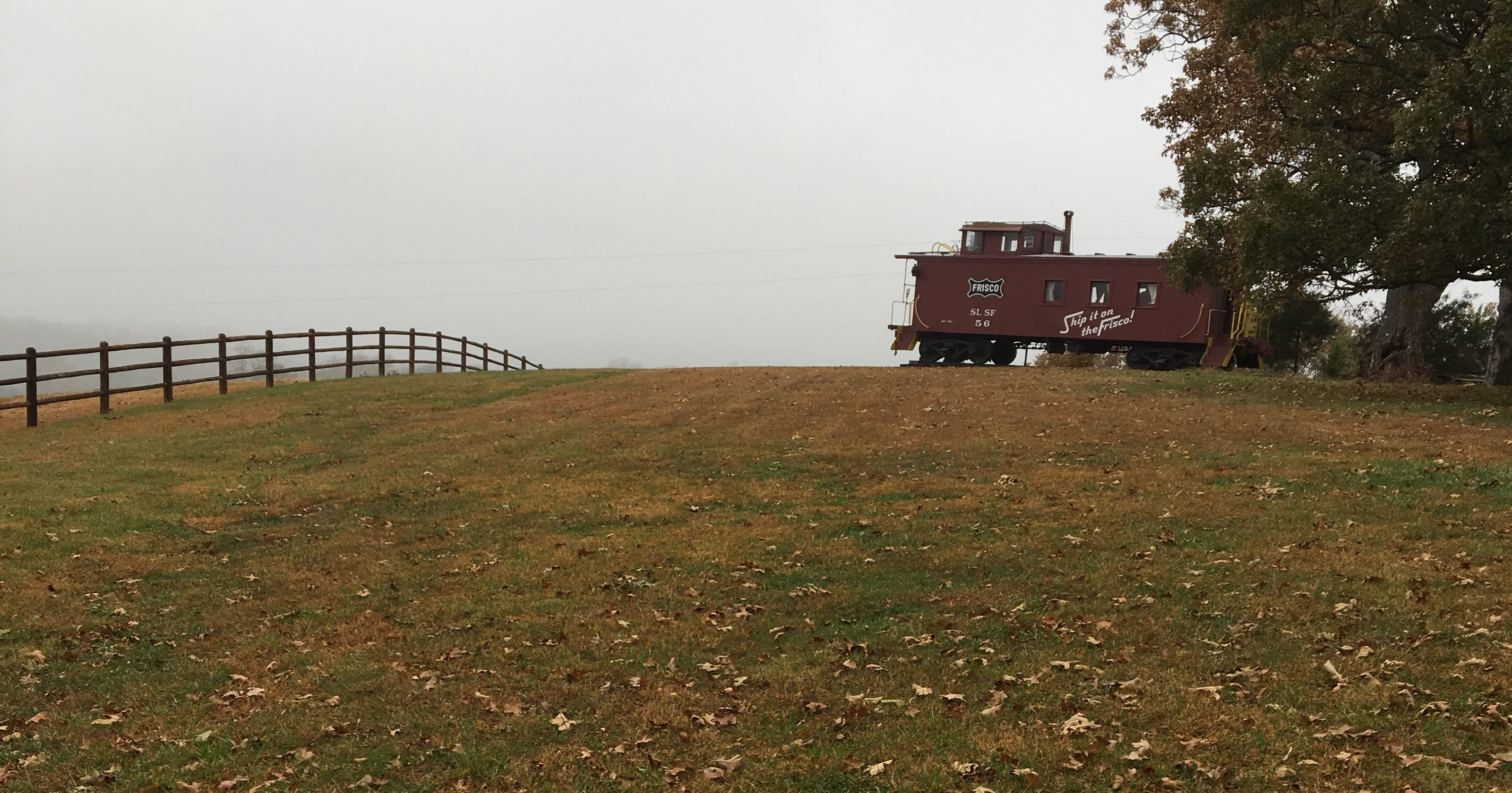 Frisco Railroad caboose on hill might involve Willie Nelson