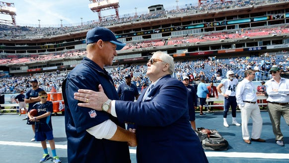 Titans president and CEO Tommy Smith shakes coach Ken