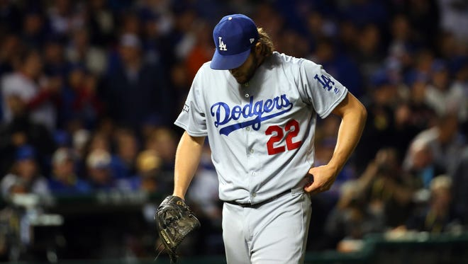 Clayton Kershaw walks off the field after the first inning after the Cubs score two runs.