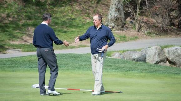David Young, left, of Sleepy Hollow Country Club, and Bill Van Orman of the Meadow Brook Club shake hands after the 18th hole of the final match of the Mastercard Met PGA Senior Match Play Championship at Whippoorwill Club in Armonk, New York on May 12, 2016. Young won the final match 1 up to capture the championship.